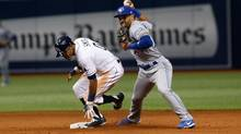 Second baseman Devon Travis of the Toronto Blue Jays gets the force out at second base on Mallex Smith of the Tampa Bay Rays during the fifth inning of a game on April 8, 2017 at Tropicana Field in St. Petersburg, Florida. (Brian Blanco/Getty Images)