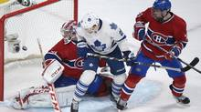 Montreal Canadiens goaltender Carey Price, left, is scored on by Toronto Maple Leafs' Phil Kessel (not shown) as Maple Leafs' James van Riemsdyk (21) and Canadiens' Alexei Emelin, right, look for a rebound during second period NHL action in Montreal, Saturday, February 9, 2013. (Graham Hughes/THE CANADIAN PRESS)