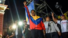 President-elect Nicolas Maduro greets supporters in Caracas late Sunday night. (MERIDITH KOHUT/NYT)