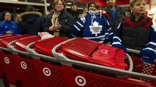 Toronto Maple Leafs' fans try to get a look as captain Dion Phaneuf and his wife, actress Elisha Cuthbert, make an in-store appearance at a Target in Toronto Dec. 9, 2013. (Kevin Van Paassen/The Globe and Mail)