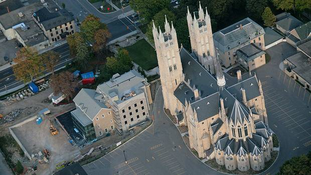 The Guelph Civic Museum, left, has opened in the former Sisters of Loretto Convent. The building is on the hilltop grounds of Our Lady of the Immaculate Conception, a national historic site and Guelph's most prominent landmark. (Peter Kelly)