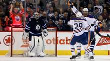 Edmonton Oilers' Leon Draisaitl (29) celebrates with teammate Patrick Maroon (19) after Maroon scored on Winnipeg Jets' goalie Ondrej Pavelec (31) during second period NHL hockey action, in Winnipeg on Sunday, Mar. 6, 2016. (Trevor Hagan/THE CANADIAN PRESS)