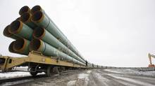 Rail cars arrive in Milton, N.D., loaded with pipe for an earlier phase of the Keystone pipeline. (Eric Hylden/The Associated Press)