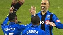 Montreal Impact's Marco Di Vaio, right, celebrates with teammates Andres Romero and Patrice Bernier after scoring against the Philadelphia Union during first half MLS action in Montreal, Saturday, May 25, 2013. (Graham Hughes/THE CANADIAN PRESS)
