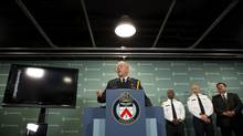 Toronto Police Chief Bill Blair held a press conference at Police Headquarters in Toronto on June 13, 2013 to provide limited information on Operation Traveller that police across the country executed earlier this morning. (Peter Power/The Globe and Mail)
