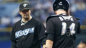 Toronto Blue Jays pitcher Shaun Marcum, left, has a discussion on the mound with catcher John Buck (14) after giving up three runs to the Tampa Bay Rays during the third inning of an American League MLB baseball game in St. Petersburg, Florida, June 9, 2010. REUTERS/Brian Blanco
