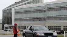 A police car leaves the training facility for the Kansas City Chiefs NFL football team on Saturday, Dec. 1, 2012, in Kansas City, Mo. (Charlie Riedel/AP)