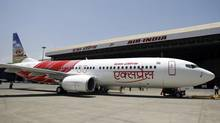 A Boeing 737-800 aircraft in the livery of Air India Express at Mumbai airport. (PUNIT PARANJPE/REUTERS)