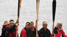 Members of the Heiltsuk First Nation, of Bella Bella, B.C., raise their oars after completing the last leg of Tribal Journeys, an annual event celebrating native culture, upon arrival in Cowichan Bay, B.C., on Monday July 28, 2008. (DARRYL DYCK/THE CANADIAN PRESS)