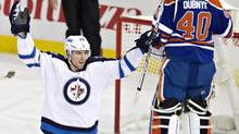 Winnipeg Jets' Blake Wheeler (26) celebrates a gaol against Edmonton Oilers goalie Devan Dubnyk (40) during first period NHL action in Edmonton, Alta., on Tuesday October 1, 2013. (JASON FRANSON/THE CANADIAN PRESS)