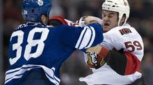 Toronto Maple Leafs left winger Fraser McLaren knocks Ottawa Senators left winger Dave Dziurzynski out during a fight (Frank Gunn/The Canadian Press)