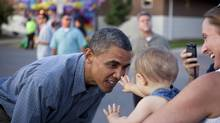 President Barack Obama greets a young fairgoer at the Iowa State Fair in Des Moines in August. (DAMON WINTER/NYT)