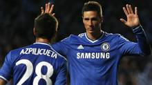 Chelsea's Fernando Torres is congratulated by Cesar Azpilicueta after scoring a goal against Atletico Madrid during their Champion's League semi-final second leg soccer match at Stamford Bridge in London April 30, 2014. (Reuters)