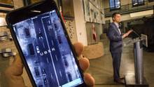 Minister of Transportation Todd Stone says he wants to see ride-sharing 'grow and flourish' alongside traditional taxi services. (John Lehman/The Globe and Mail)