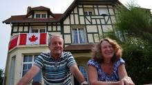 Hervé Hoffer and his wife, Nicole, outside their summer-home-turned-museum in Bernières-sur-Mer in 2012. (Richard Foot)