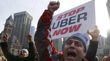 """Taxi drivers protest in front of city hall against the Uber ridesharing car service in Toronto December 9, 2015. Toronto's city council voted in October to create a legal framework covering ride-sharing companies such as Uber Technologies Inc, asking city staff to suggest rules by next spring that would create a """"level playing field"""" with taxis. It also passed a motion asking Uber to stop operations in the city until the rules are in place. Uber's general manager for Canada, Ian Black, said the company intends to ignore that request, media reported on Twitter after the meeting concluded. REUTERS/Chris Helgren (CHRIS HELGREN/REUTERS)"""