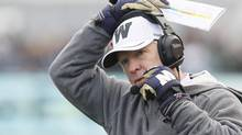 Winnipeg Blue Bombers' head coach Tim Burke adjusts his headset during the first half of their CFL game against Montreal Alouettes in Winnipeg on Saturday, November 3, 2012. (John Woods/THE CANADIAN PRESS)