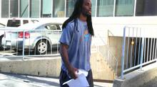 Saskatchewan Roughriders' Taj Smith leaves provincial court in Regina on Thursday, Sept. 12, 2013. Two members of the Roughriders football team have been charged with aggravated assault following a fight at a nightclub last month. (Jennifer Graham/THE CANADIAN PRESS)