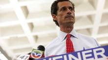 New York mayoral candidate Anthony Weiner attends a news conference in New York July 23, 2013. Weiner, with his wife by his side, said he is staying in the race after confirming on Tuesday that some newly revealed sexually explicit online chats and photos, published this week by a gossip website, were sent by him. (ERIC THAYER/REUTERS)