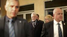 Quebec Liberal leader Philippe Couillard arrives at his election rally headquarters with his wife Suzanne Pilote in St. Felicien, Quebec, April 7, 2014. (MATHIEU BELANGER/REUTERS)