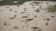 Flooded homes along the Bow River at the Siksika First Nation east of Calgary on June 23, 2013. (John Lehmann/The Globe and Mail)