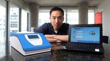 Paul Lem, CEO of Spartan Bioscience Inc., poses with Spartan RX, a box the size of a shoebox that delivers DNA test results. (Dave Chan For The Globe and Mail)