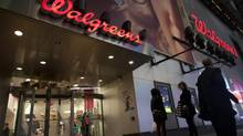 Shoppers walk by at the Walgreen's Times Square store in New York. The Centers For Disease Control is projecting the worst flu season in 10 years, and Walgreen has seen strong demand for flu shots and other immunizations. (Andrew Kelly/Reuters)
