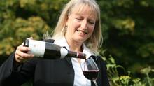 Sommelier Véronique Rivest pour a glass of red wine in this Sept. 23, 2008 file photo in Chelsea, Que. Rivest placed second at a worldwide sommelier competition that wrapped up Friday in Tokyo, Japan. (Michel Lafleur/CP)
