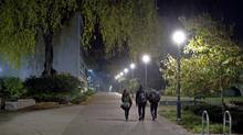 UBC's 400-hectare campus is the scene of an intense hunt for a suspect in six sex attacks since spring. Students walk through UBC campus at night in Vancouver, British Columbia on October 31, 2013. (BEN NELMS for The Globe and Mail) (BEN NELMS for the globe and mail)