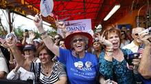 Supporters of U.S. Republican presidential candidate Mitt Romney cheer during a campaign event at El Palacio De Los Jugos in Miami, Fla., Aug. 13, 2012. (SHANNON STAPLETON/Reuters)