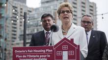 Ontario Premier Kathleen Wynne is joined by Finance Minister Charles Sousa, left, and Housing Minister Chris Ballard in Toronto on Thursday, April 20, 2017, to announce details of the government's plan to curb real estate speculation. (Christopher Katsarov/The Canadian Press)