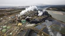 The oil sands industry is waiting to see if the Alberta government's climate policy will help build public support for pipeline proposals. (TODD KOROL/REUTERS)
