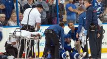 Tampa Bay Lightning defenseman Michael Kostka (21) is treated by trainers after being knocked unconscious by Montreal Canadiens defenceman Douglas Murray (not pictured) at Tampa Bay Times Forum. Murray was ejected for the hit. (Jeff Griffith/USA Today Sports)