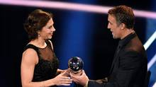 Houston Dash and U.S. midfielder Carli Lloyd is presented with the Women's Player of 2016 Award by former Argentine footballer Gabriel Batistuta on January 9, 2017 in Zurich. (FABRICE COFFRINI/AFP/Getty Images)