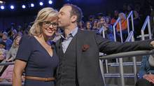 This image released by ABC shows co-host Jenny McCarthy with her fiance Donnie Wahlberg after she announced her engagement on the daytime series The View, Wednesday, April 16, 2014 in New York. (Heidi Gutman/AP)