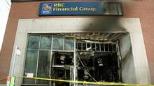 Damage is seen Wednesday, May 19, 2010 that was caused by a firebomb at an Ottawa downtown bank early Tuesday morning. Anarchists who claimed to have firebombed the bank are vowing to take their protest to the upcoming G8 and G20 summits in Ontario. (The Canadian Press/Fred Chartrand)