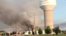 Firefighters try to put out a fire at the Bonduelle food-processing plant in Tecumseh, Ont., near Windsor, on Friday, July 18, 2014. (Robert Allen/Detroit Free Press/AP)