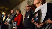 Rob Nicholson, Minister of Justice and Attorney General of Canada, third from left, is accompanied by victims of crime, as he makes an announcement in the Foyer of the House of Commons on Parliament Hill in Ottawa on Tuesday, October 23, 2012 regarding criminal justice legislation. (Sean Kilpatrick/THE CANADIAN PRESS)