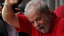 Former Brazilian President Luiz Inacio Lula da Silva waves to the crowd from his home in Sao Bernardo do Campo, Brazil, March 5, 2016. (PAULO WHITAKER/REUTERS)