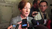 """Alison Redford is pictured in Edmonton on May 5, 2014. Ms. Redford and her staff """"used public resources inappropriately"""" and sidestepped provincial rules through travel spending and personal use of government planes, according to an audit that found Ms. Redford commanded an """"aura of power"""" that led few people to question her or her office. (Dean Bennett/THE CANADIAN PRESS)"""