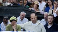 Avi and Rachel Fraenkel attend the funeral of their son, Naftali, a 16-year-old with dual Israeli-American citizenship, in the West Bank Jewish settlement of Nof Ayalon, Tuesday, July 1, 2014. The Israeli military found the bodies of three missing teenagers just over two weeks after they were abducted in the West Bank — a grim discovery that ended a frantic search that led to Israel's largest ground operation in the Palestinian territory in nearly a decade and drew Israeli threats of retaliation. (Tomer Appelbaum/AP)