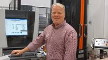 Shimco CEO Peter Voss with the company's Mazak FMS (flexible manufacturing system) machine. (Shimco)