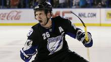 The Tampa Bay Lightning will retire Martin St. Louis's jersey. (Chris O'Meara/AP)
