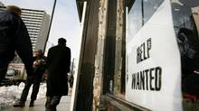 A help wanted sign is posted in the window of a Toronto store. (CHARLA JONES/THE GLOBE AND MAIL)