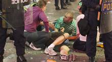 An injured rioter lays on the ground in downtown Vancouver June 15, 2011. (John Lehmann/The Globe and Mail/John Lehmann/The Globe and Mail)
