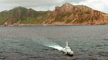 A ship from Japan's Maritime Safety Agency patrol boat sails near the disputed Senkaku isalnds, known as the Diaoyu islands in Chinese. (Kyodo/Reuters)
