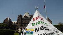 Protesters erect a 30-foot-high teepee at Queen's Park in Toronto on June 25, 2007. The Ojibway of Grassy Narrows First Nation have been fighting the Ontario government for years over a proposed forestry clear-cutting development. They argue the federal government should be the trustee of their lands, not the province. (KEVIN VAN PAASSEN/THE GLOBE AND MAIL)