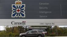 A vehicle passes a sign outside the Canadian Security Intelligence Service (CSIS) headquarters in Ottawa November 5, 2014. REUTERS/Chris Wattie (CANADA - Tags: POLITICS CRIME LAW) (CHRIS WATTIE/REUTERS)