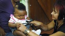A research nurse gives an infant a check-up as part of a clinical trial to develop new TB vaccines at the South African Tuberculosis Vaccine Initiative's clinical trial field site in Worcester, South Africa. (REUTERS)