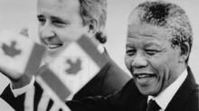 Nelson Mandela and Prime Minister Brian Mulroney make their way through a crowd of onlookers after the South African leader's arrival in Ottawa on June 17, 1990. (Moe Doiron/Moe Doiron/Reuters)